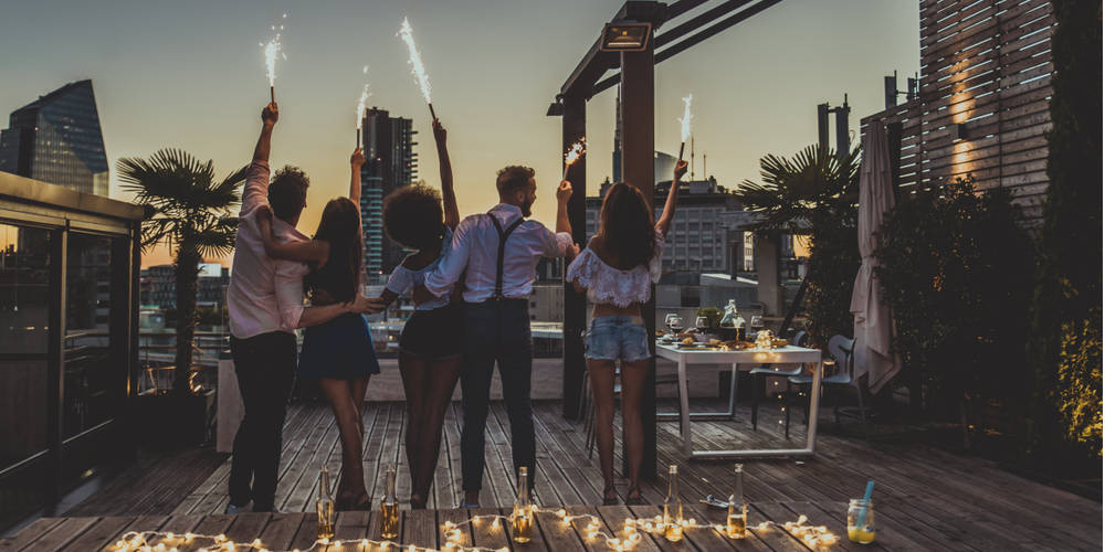 group celebrating on rooftop